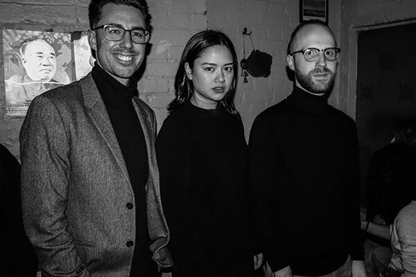 Ch'an, Adam and Annemarie doing a Steve Jobs pose while wearing turtlenecks
