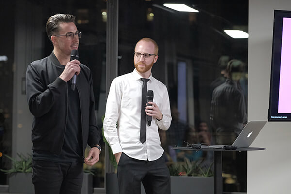 Ch'an and Adam hosting the event on stage