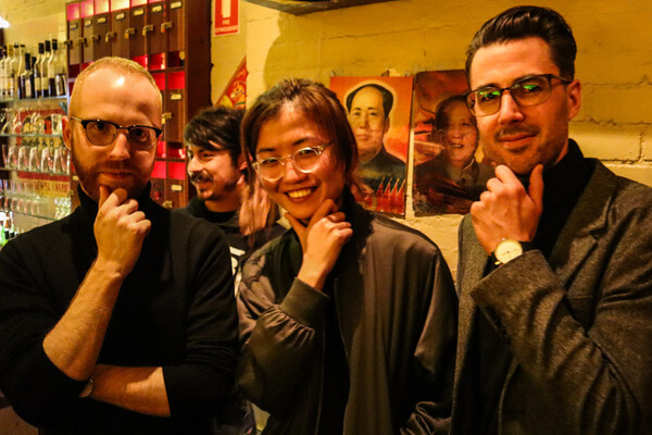 Ch'an, Adam and Shuying doing a Steve Jobs pose while wearing turtlenecks